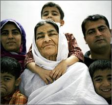 Zahida Bibi, a Pakistani woman with diabetes, wearing a white shawl and surrounded by her family.