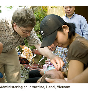 Bill Gates administers an oral polio vaccine to a baby.