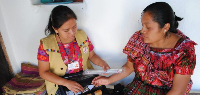 A family planning user and a health promoter discuss contraceptive methods in El Quiché, Guatemala.