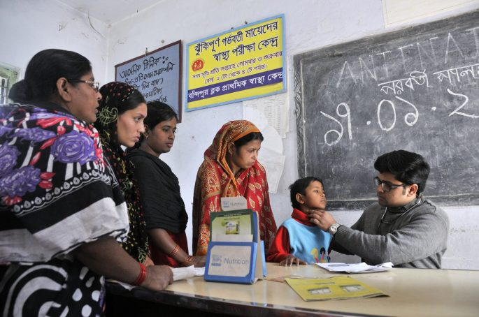 In a remote village of Bandipur, West Bengal, India, women and children line up for examination by a single junior doctor at a block level health care center.